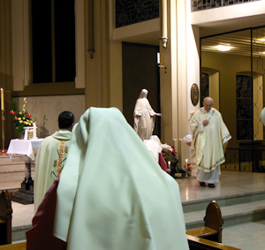 Fr.Puhl put the Infant Jesus on the crib